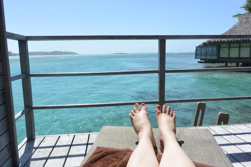 Someone had happy toes looking out their overwater bungalow!