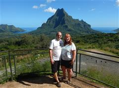 Pat and Dennis with the mountains in Tahiti