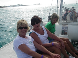 Pat, Sandy and Colleen on the catamaran