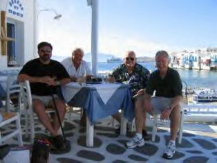 Guys enjoy a break in Mykonos, Greece